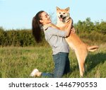 Stock photo young woman with adorable akita inu dog in park 1446790553