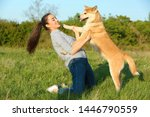 Stock photo young woman with adorable akita inu dog in park 1446790559