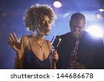 female singer and saxophonist... | Shutterstock . vector #144686678