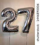 Small photo of Big balloons in the form of figures - twenty seven