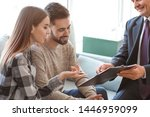 Small photo of Couple meeting with notary public in office