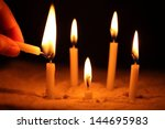 hand with candle | Shutterstock . vector #144695983