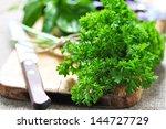 parsley on cutting board | Shutterstock . vector #144727729