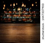 Stock photo wooden brown table and vintage lamps with blurred liquor bar background 1447337903