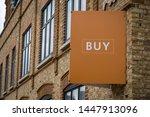 A Estate Agent 'buy' Sign Board ...