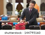 Businessman Shopping In Clothe...