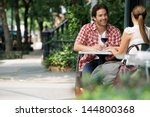couple drinking wine at... | Shutterstock . vector #144800368