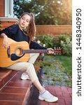 guitarist girl play music on... | Shutterstock . vector #1448340950