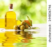 olives and bottle of oil, food backgrounds - stock photo