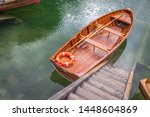 Rowboat At The Dock On A Lake