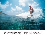 young caucasian man surfs the...   Shutterstock . vector #1448672366