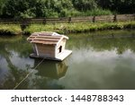 Small Wooden House On Water...