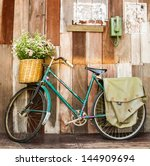 vintage bicycle on vintage... | Shutterstock . vector #144909694