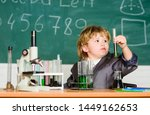 boy microscope and test tubes... | Shutterstock . vector #1449162653