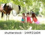 young mother with her daughters ... | Shutterstock . vector #144921604