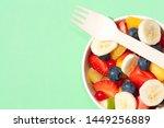bowl of healthy fresh fruit... | Shutterstock . vector #1449256889