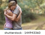 side view of a couple standing... | Shutterstock . vector #144943360