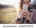 happy young woman wearing beige ...   Shutterstock . vector #1449574070