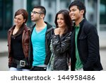 four young happy people walking ... | Shutterstock . vector #144958486