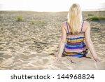woman in lined dress take... | Shutterstock . vector #144968824