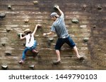 Father And Daughter Climbing A...
