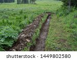 earthen ditch in the summer... | Shutterstock . vector #1449802580