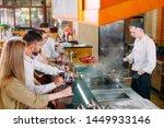 the chef prepares food in front ... | Shutterstock . vector #1449933146