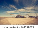 abandoned gas station along the ... | Shutterstock . vector #144998329