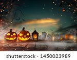 Stock photo halloween pumpkins on dark spooky forest with blue fog in background 1450023989