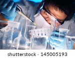 scientist holds and examine... | Shutterstock . vector #145005193