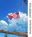 American Flag blowing in the wind on a American Tall Ship moored near Queen