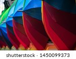 Red And Blue Umbrellas Lined U...