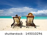 couple on a tropical beach at... | Shutterstock . vector #145010296