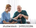 Nurse Reading Book To Elderly...