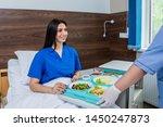 Nurse In Medical Coat Is...