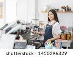 happy asian woman barista... | Shutterstock . vector #1450296329