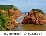 Red Jurassic Cliffs Near Ladra...