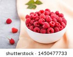Fresh Raspberry In White Bowl...