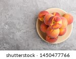 fresh peaches on a plate on... | Shutterstock . vector #1450477766