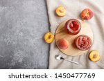 peach jam in a glass jar with... | Shutterstock . vector #1450477769
