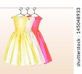 2 Dresses On The Hanger In...