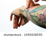 Female Tattooed Hands Hold A...