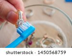 jeweller hand cleaning and... | Shutterstock . vector #1450568759