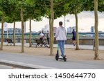 People use and ride E-scooters, trendy urban transportation with Eco friendly mobility concept by sharing Electric Scooter, at promenade riverside of Rhine River in Düsseldorf, Germany.