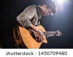 Guitarist  Music. A Young Man...