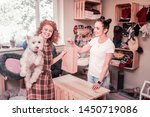Stock photo happy after shopping curly red haired woman feeling happy after shopping in pet shop with her 1450719086
