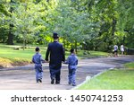 Small photo of Religious Jew. A family of Hasidic Jews, a man with children, walks through the Autumn Park in Uman, Ukraine, Jewish New Year holiday