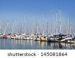 Small Sailboats In A Harbor