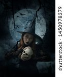 Halloween Witch Holding A Skul...