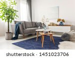 flowers on wooden coffee table... | Shutterstock . vector #1451023706